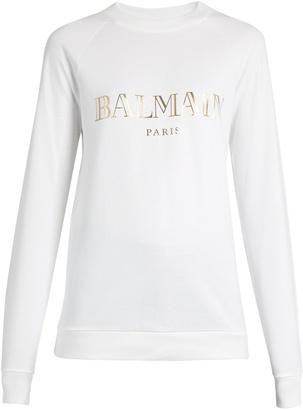 BALMAIN Logo-print cotton-jersey sweatshirt $351 thestylecure.com