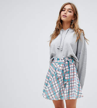 Glamorous Petite wrap tie mini skirt in check