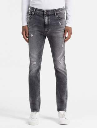 Calvin Klein skinny tapered faded black jeans