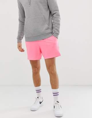 Asos Design DESIGN jersey shorts in shorter length in neon pink