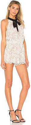 Endless Rose Tied Ribbon Lace Romper in White $99 thestylecure.com