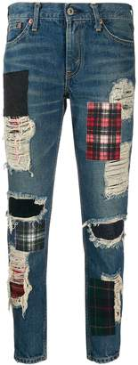 Junya Watanabe ripped patch jeans