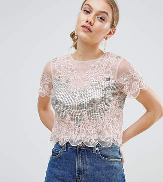 Asos DESIGN Petite t-shirt with all over sequins & pretty lace detail in pink