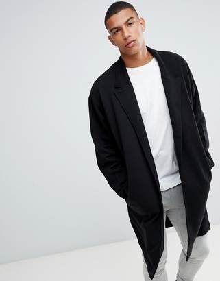 Asos DESIGN oversized jersey duster jacket in black