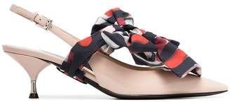 Prada cream, black and red bow front 55 patent leather slingback pumps