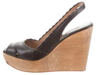 Alaia Leather Wedge Sandals