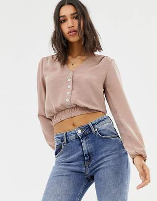 Love long sleeve cropped top with button front detail