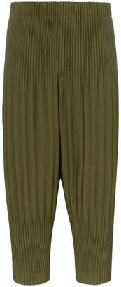 Issey Miyake Homme Plissé Cropped tapered pleated trousers