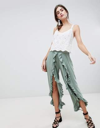 Asos DESIGN wide leg pants with high low frill hem