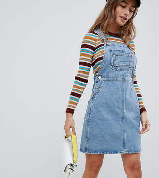 Asos DESIGN Petite denim overall dress in vintage blue