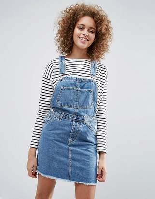 ASOS Denim Classic Overall Dress With Raw Hem in Mid Wash Blue $60 thestylecure.com