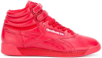 Reebok Freestyle hi-top sneakers $111.65 thestylecure.com