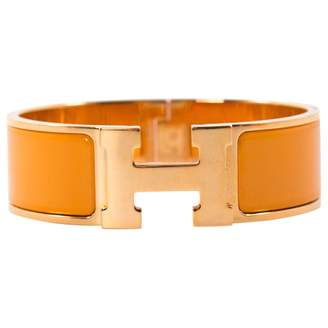 Hermes Clic H Yellow Metal Bracelets