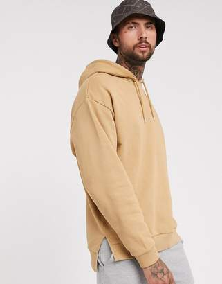 Asos Design DESIGN oversized hoodie with split and dropped hem in tan