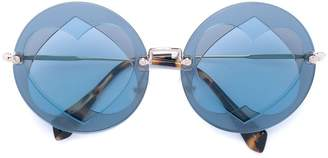Miu Miu Collection round sunglasses