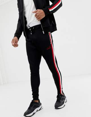 Club Skinny The Couture joggers with side stripe
