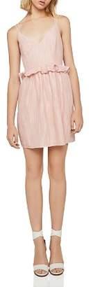 BCBGeneration Crisscross Peplum Dress