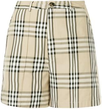 Andrea Crews snap button checked shorts