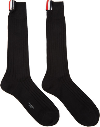Thom Browne Black Ribbed Socks $90 thestylecure.com