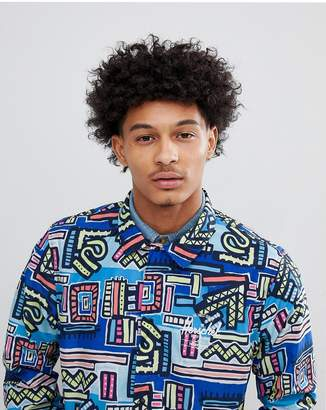 Herschel Hoffman Collab Packable Coach Jacket with Back Print in Blue Abstract Print