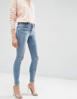 Asos DESIGN Lisbon Mid Rise Skinny Jeans In Shelby Light Stonewash with Shredded Knees and Chewed Hems