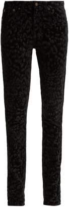 Saint Laurent Flocked velvet leopard-print jeans