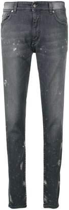 Represent mid-rise paint splatter jeans