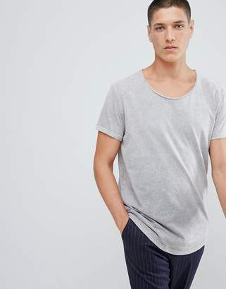 Asos DESIGN relaxed longline t-shirt with scoop neck and curved hem in ombre acid wash