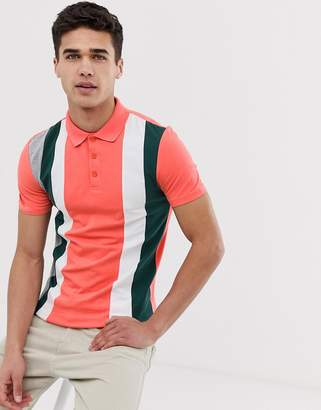 Asos Design DESIGN muscle fit polo shirt with vertical colour block in pink