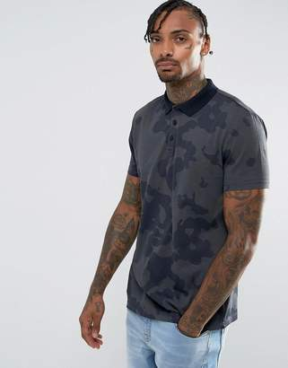 Asos Design Polo Shirt In Camo Print And Heavy Wash