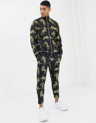 Asos DESIGN track jacket/skinny joggers in poly tricot fabric with leopard print
