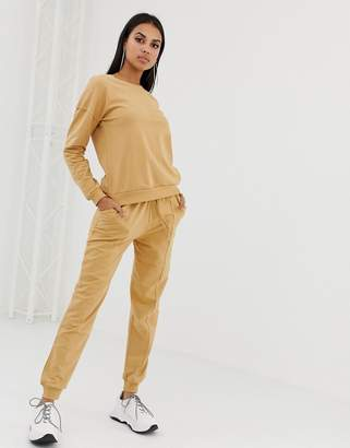 Asos Design DESIGN tracksuit sweatshirt with contrast stitch / jogger with tie
