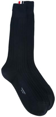 Thom Browne ribbed mid-calf socks $108.84 thestylecure.com