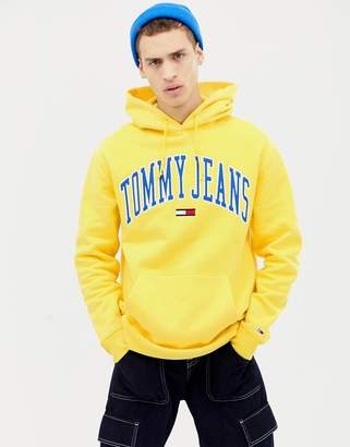 a7f2a65d Tommy Jeans relaxed fit collegiate capsule hoodie in yellow