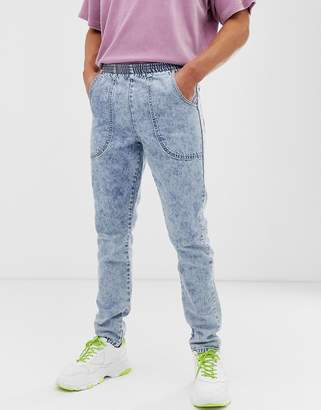 Asos Design DESIGN slim jeans in acid wash blue with elasticated waist