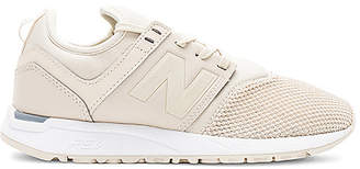 New Balance 247 Sneaker in Beige $80 thestylecure.com