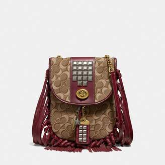Coach Fringe Saddle Bag In Signature Jacquard With Pyramid Rivets