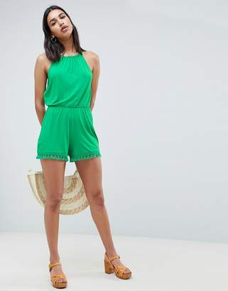 Asos DESIGN jersey halter neck romper with tassel hem