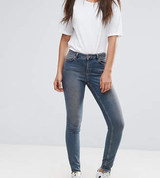 Asos Tall TALL LISBON Skinny Mid Rise Jeans in Dita Tinted Mid Wash with Reverse Stepped Hem