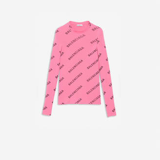 Balenciaga Allover Logo Crewneck in bright pink and black technical ribbed knit