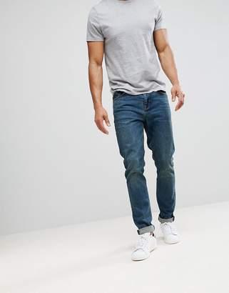 Asos DESIGN skinny jeans in vintage dark wash