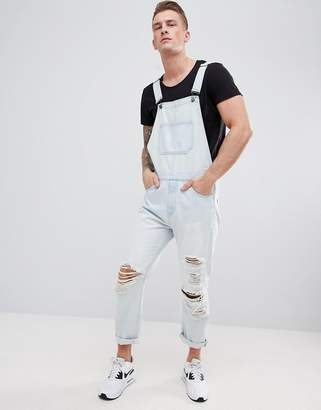 Asos DESIGN Skinny Denim Overalls In Light Wash Blue With Heavy Rips