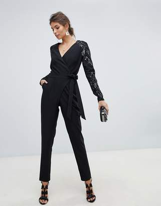 93dcd7581b9 Little Mistress wrap front jumpsuit with sequin sleeves and exposed back