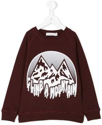 Stella McCartney climb a mountain sweater