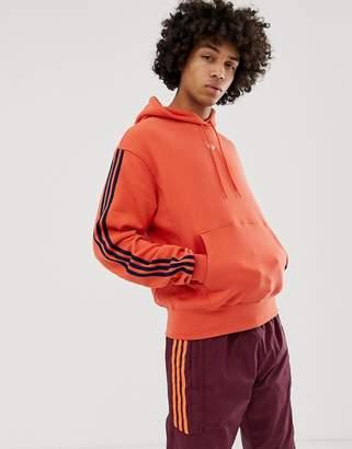 adidas Floating Stripe Hoodie in orange