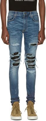 Amiri Indigo Skinny MX1 Patch Jeans $1,040 thestylecure.com