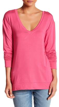 Couture Go Deep V-Neck Open Back Long Sleeve Tee
