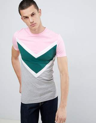 Asos DESIGN muscle fit t-shirt with chevron cut and sew panel in pink