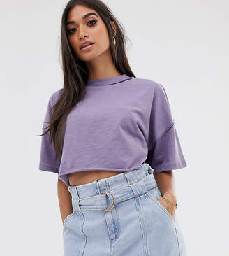 Asos DESIGN Petite boxy crop t-shirt with exposed seams in lilac