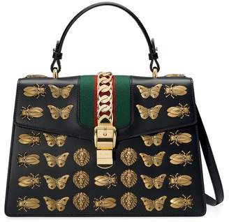 Gucci Sylvie animal studs leather top handle